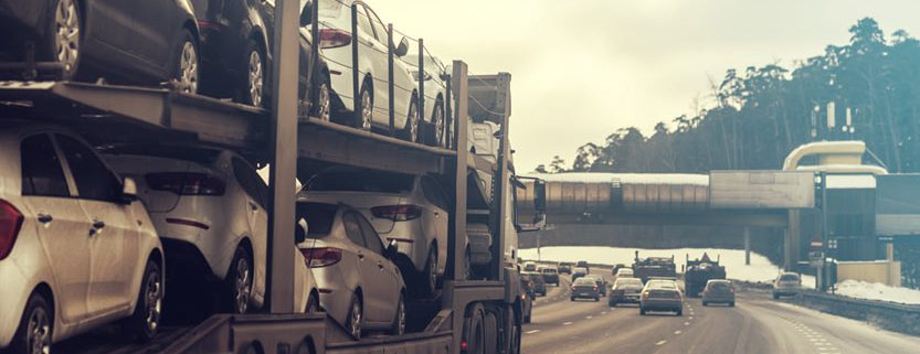 The trailer transports cars on highway