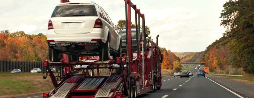 trucks transporting cars