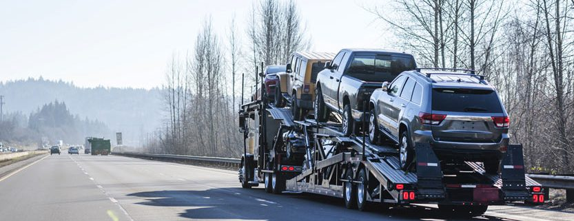Big rig car hauler semi truck transporting cars